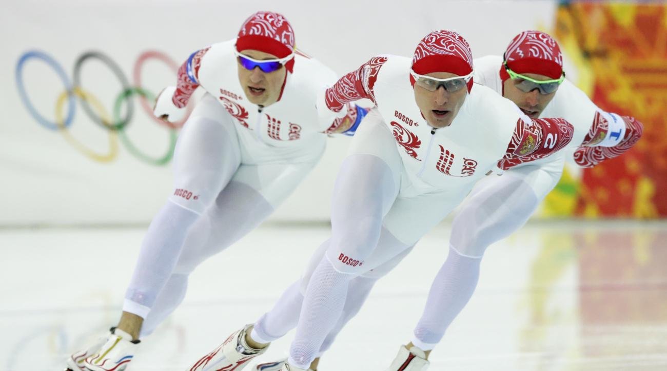 Team Russia competes in the men's speedskating team pursuit quarterfinals at the Adler Arena Skating Center during the 2014 Winter Olympics in Sochi, Russia, Friday, Feb. 21, 2014. (AP Photo/Matt Dunham)