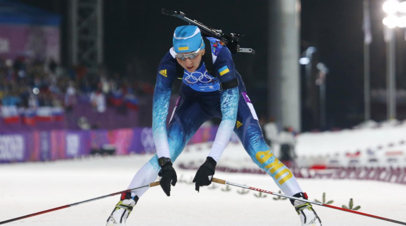 Ukraine's Olena Pidhrushna crosses the finish line to win the gold during the women's biathlon 4x6k relay, at the 2014 Winter Olympics, Friday, Feb. 21, 2014, in Krasnaya Polyana, Russia. (AP Photo/Dmitry Lovetsky)