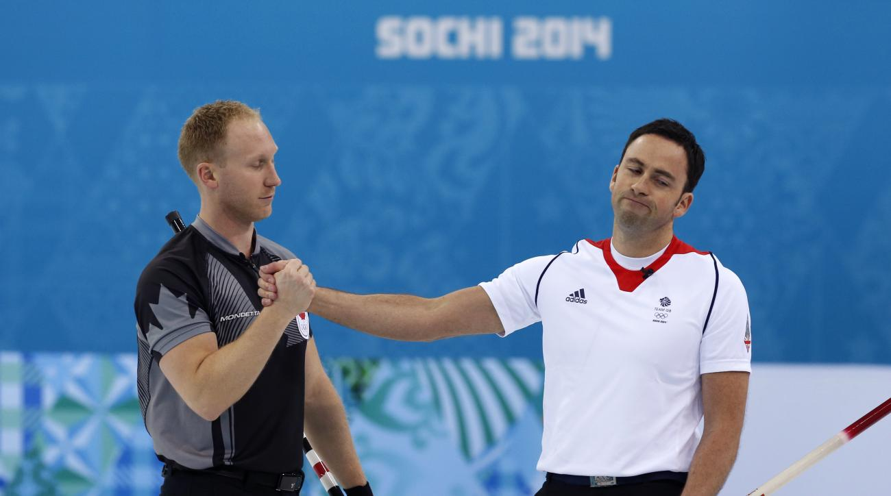 Canada's skip Brad Jacob, left, shakes Britain skip David Murdoch's hand after defeating his team in the men's curling gold medal game at the 2014 Winter Olympics, Friday, Feb. 21, 2014, in Sochi, Russia. (AP Photo/Robert F. Bukaty)
