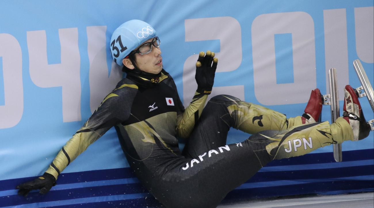 Satoshi Sakashita of Japan crashes out in a men's 500m short track speedskating quarterfinal at the Iceberg Skating Palace during the 2014 Winter Olympics, Friday, Feb. 21, 2014, in Sochi, Russia. (AP Photo/Bernat Armangue)