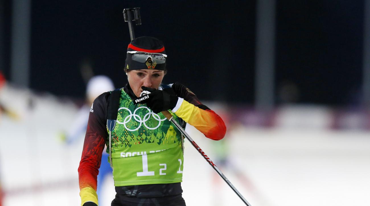 Germany's Andrea Henkel rubs her nose during the women's biathlon 4x6k relay, at the 2014 Winter Olympics, Friday, Feb. 21, 2014, in Krasnaya Polyana, Russia. (AP Photo/Dmitry Lovetsky)