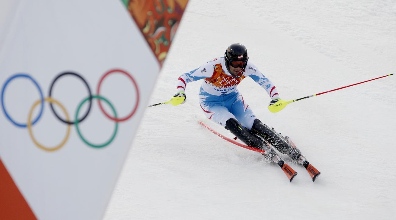 Austria's Mario Matt nears the finish in the men's slalom at the Sochi 2014 Winter Olympics, Saturday, Feb. 22, 2014, in Krasnaya Polyana, Russia. (AP Photo/Christophe Ena)