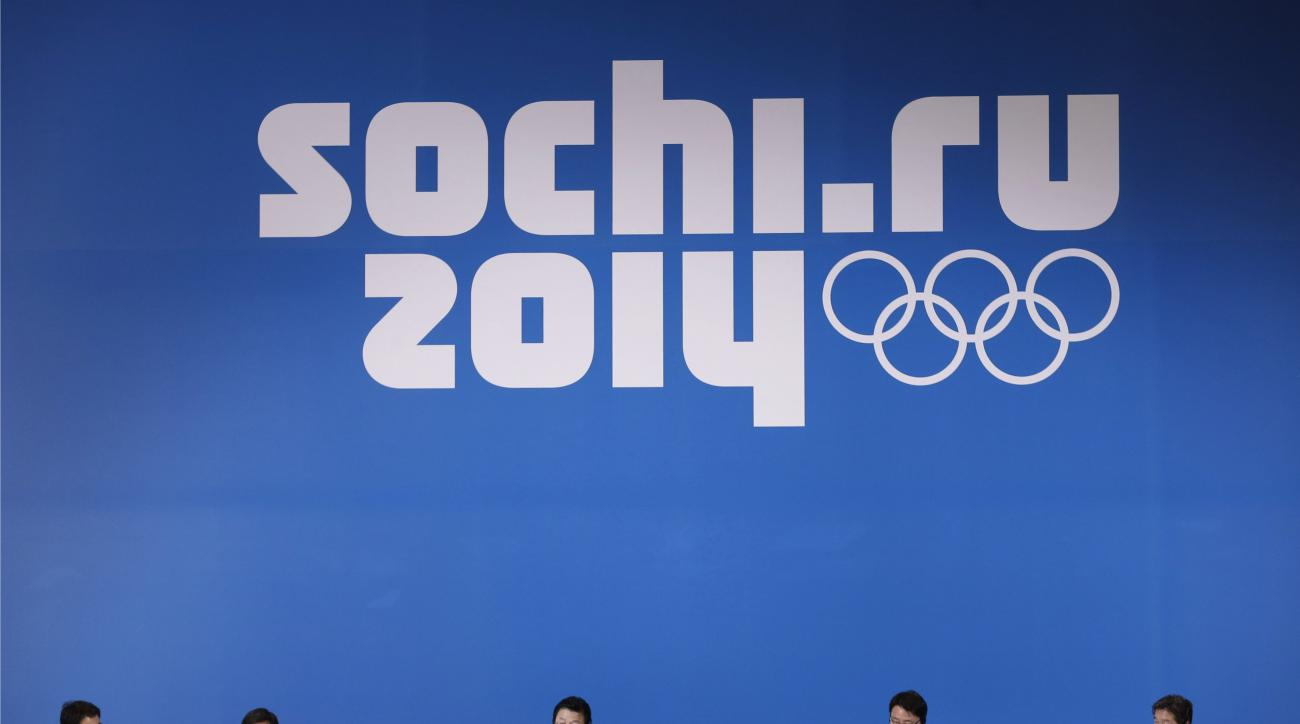 A delegation from the 2018 Pyeongchang Olympic Winter Games attend a press conference during the 2014 Winter Olympics, Saturday, Feb. 22, 2014, in Sochi, Russia. (AP Photo/Bernat Armangue)