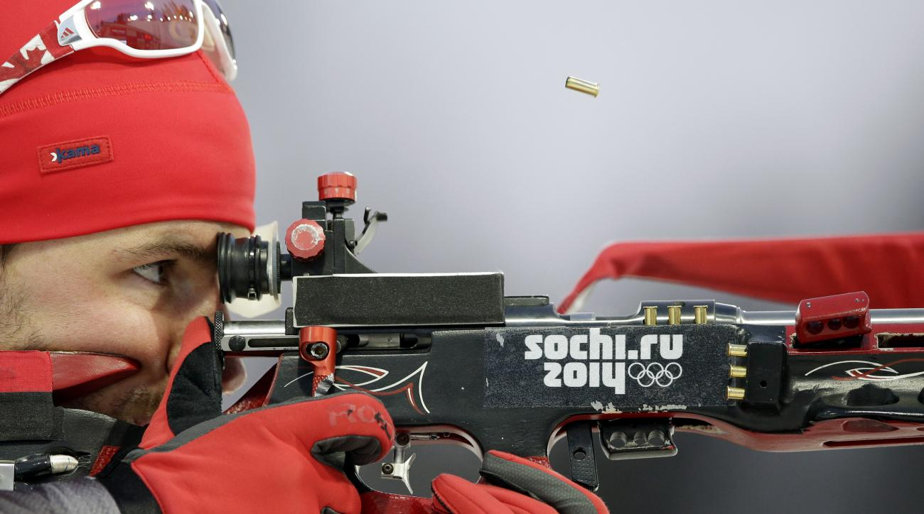 Canada's Jean-Philippe le Guellec shoots during the men's biathlon 4x7.5K relay at the 2014 Winter Olympics, Saturday, Feb. 22, 2014, in Krasnaya Polyana, Russia. (AP Photo/Lee Jin-man)