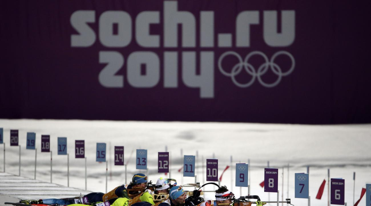Competitors line up in the shooting range during the men's biathlon 4x7.5K relay at the 2014 Winter Olympics, Saturday, Feb. 22, 2014, in Krasnaya Polyana, Russia. (AP Photo/Felipe Dana)