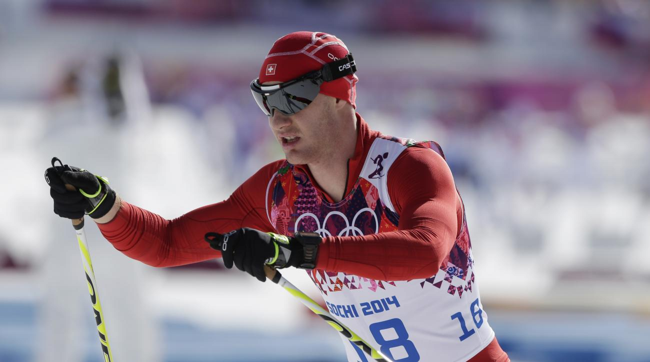Switzerland's Dario Cologna competes during the men's 50K cross-country race at the 2014 Winter Olympics, Sunday, Feb. 23, 2014, in Krasnaya Polyana, Russia. (AP Photo/Matthias Schrader)