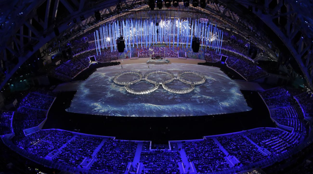 Performers create the Olympic rings during the closing ceremony of the 2014 Winter Olympics, Sunday, Feb. 23, 2014, in Sochi, Russia. (AP Photo/David J. Phillip )