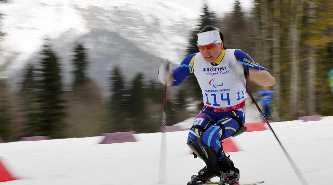 Lyudmyla Pavlenko of Ukraine races to win the ladies 12km cross country ski, sitting event at the 2014 Winter Paralympic, Sunday, March 9, 2014, in Krasnaya Polyana, Russia. (AP Photo/Dmitry Lovetsky)