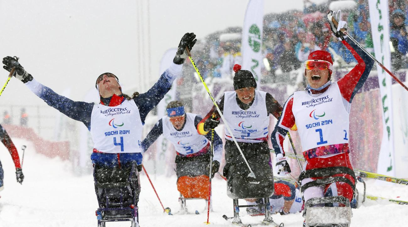 10ThingstoSeeSports - Mariann Marthinsen, right, of Norway, celebrates her gold medal as Tatyana Mcfadden, left, of United States, reacts to her second-place finish in the finals of the women's cross country 1km sprint, sitting event at the 2014 Winter Paralympic, Wednesday, March 12, 2014, in Krasnaya Polyana, Russia. (AP Photo/Dmitry Lovetsky, File)