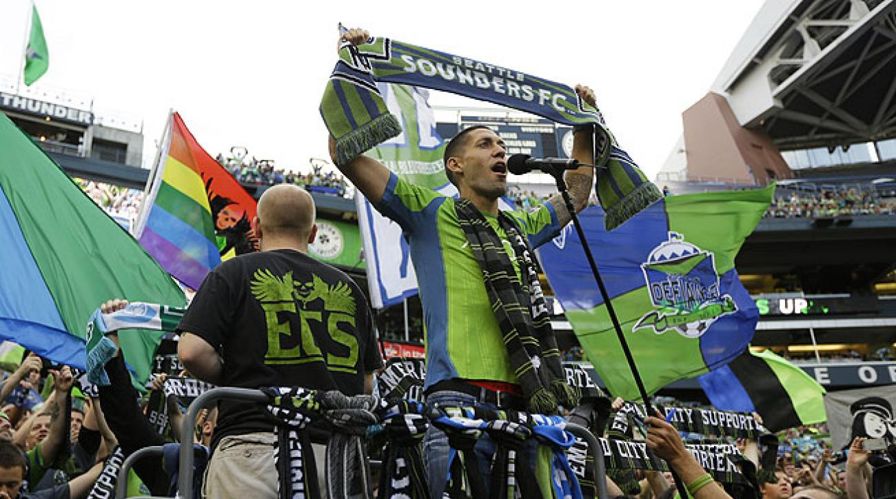 Clint Dempsey (holding scarf) received an ecstatic welcome from Sounders supporters in Seattle.
