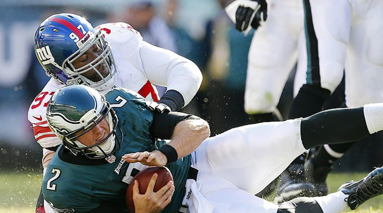 Filling in for an injured Michael Vick, Matt Barkley (top) went 17-of-26 for 158 yards and an interception.