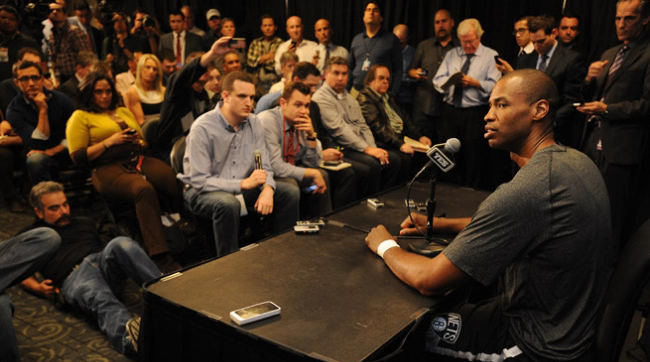 Jason Collins became the NBA's first openly gay player to play in a game on Sunday against the Lakers.