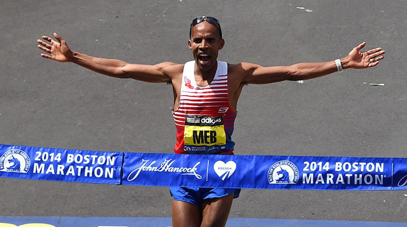 Meb Keflezighi crosses the Boston Marathon finish line 11 seconds ahead of the second-place runner.