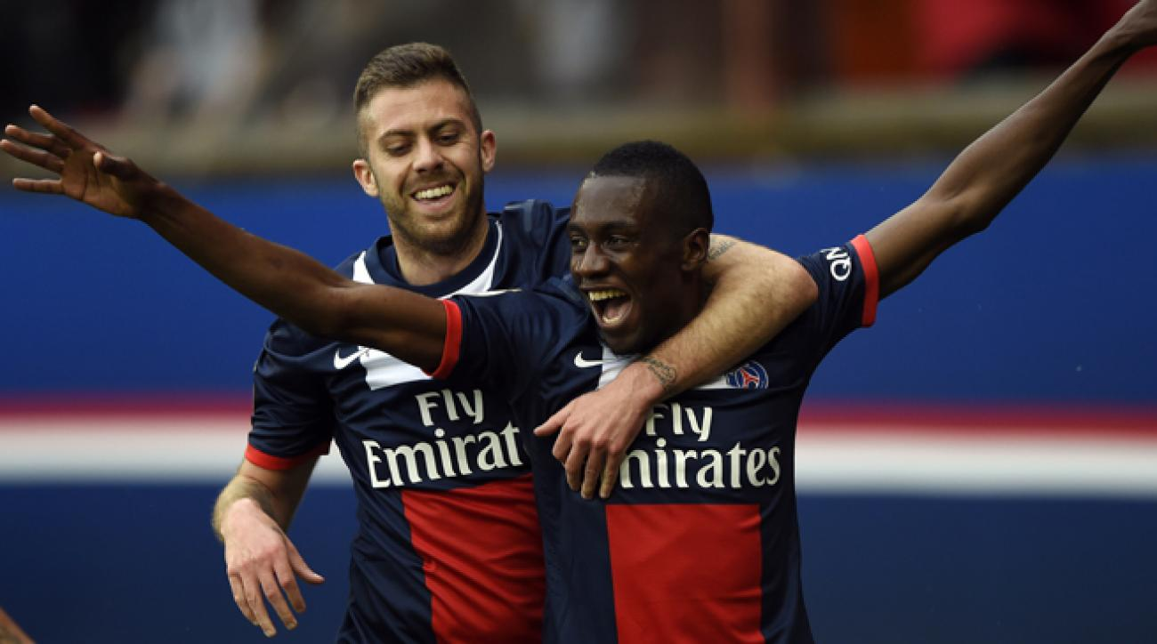 PSG's Blaise Matuidi is congratulated by teammate Jeremy Menez after his late winner over Evian put the capital club within a win of the Ligue 1 title.