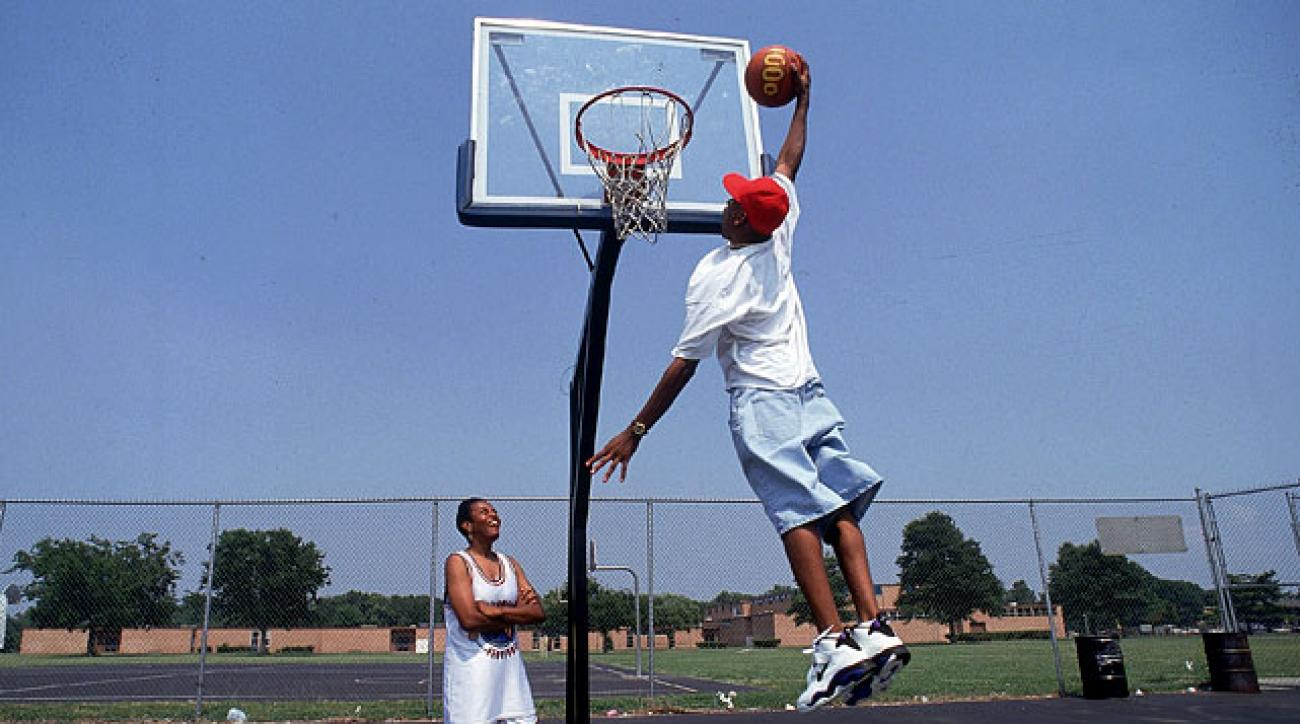 Iverson shows off his dunking ability for his mother, Ann, at a court in Hampton, Va. AI pieced together a sparkling career for Hampton's Bethel High, catching the eye of Georgetown's John Thompson, who offered him a scholarship.