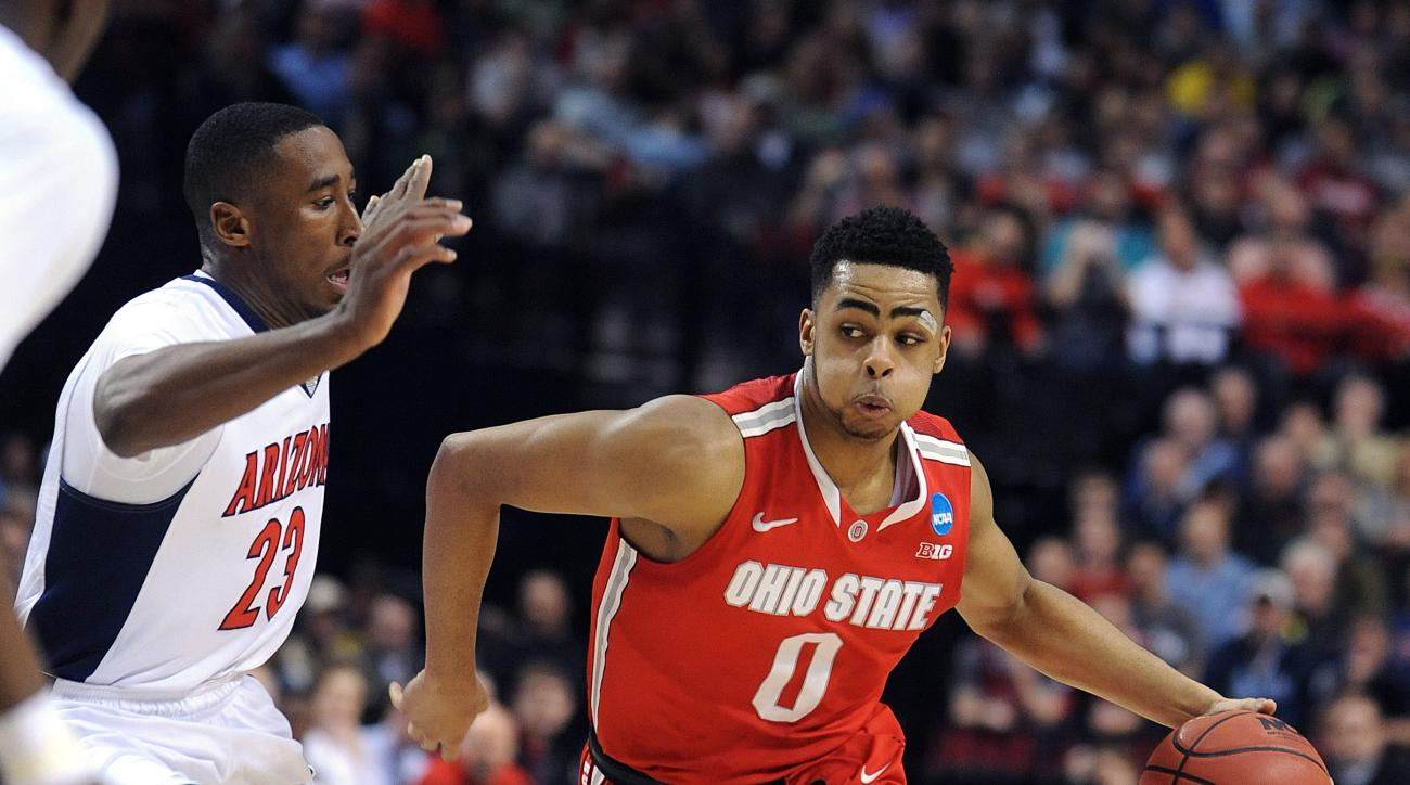 Ohio State guard D'Angelo Russell, right, drives on Arizona forward Rondae Hollis-Jefferson during an NCAA college basketball tournament round of 32 game in Portland, Ore., Saturday, March 21, 2015. (AP Photo/Greg Wahl-Wtephens)