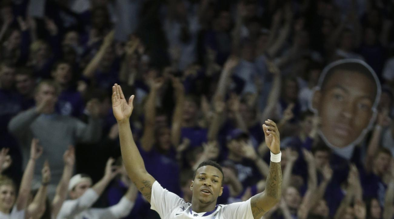 Kansas State guard Marcus Foster (2) celebrates a basket late in the second half of an NCAA college basketball game against Oklahoma Staten in Manhattan, Kan., Saturday, Jan. 24, 2015. Kansas State won 63-53. (AP Photo/Orlin Wagner)