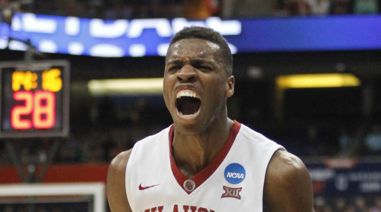 Oklahoma's Buddy Hield reacts during the first half of a regional semifinal against the Oklahoma in the NCAA men's college basketball tournament Friday, March 27, 2015, in Syracuse, N.Y. (AP Photo/Nick Lisi)