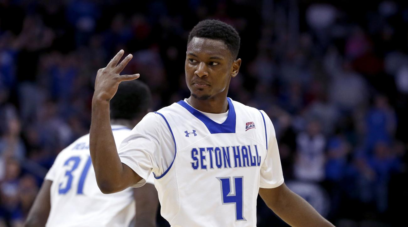 Seton Hall guard Sterling Gibbs gestures after scoring a shot against St. John's during the second half of an NCAA college basketball game, Wednesday, Dec. 31, 2014, in Newark, N.J. Seton Hall won 78-67. (AP Photo/Julio Cortez)