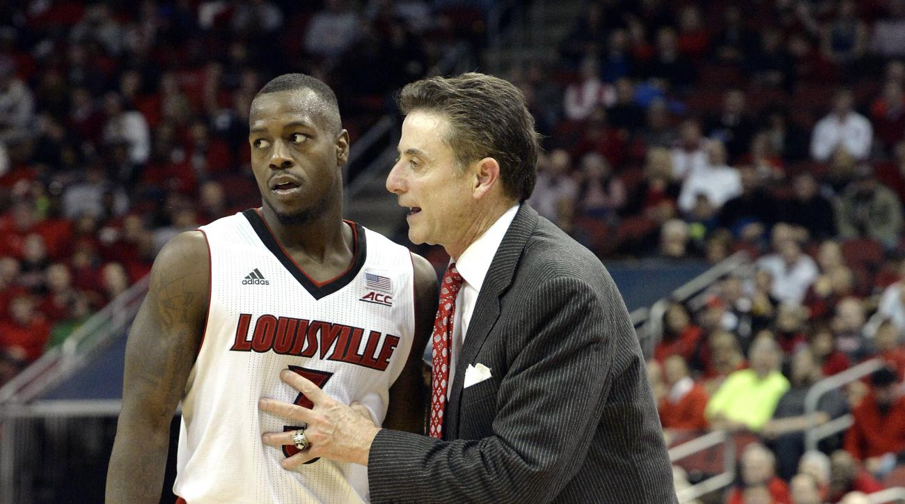 FILE - In this Nov. 14, 2014, file photo, Louisville head coach Rick Pitino, right, talks with Chris Jones during the second half of an NCAA college basketball game against Jacksonville State in Louisville, Ky. Former Louisville basketball player Chris Jo