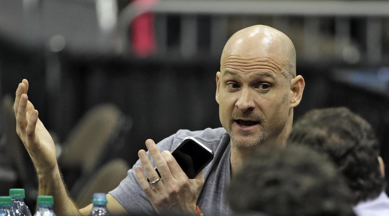 Mississippi head coach Andy Kennedy takes part in an interview during practice for an NCAA college basketball second round game Wednesday, March 18, 2015, in Jacksonville, Fla. Mississippi takes on Xavier on Thursday. (AP Photo/Chris O'Meara)