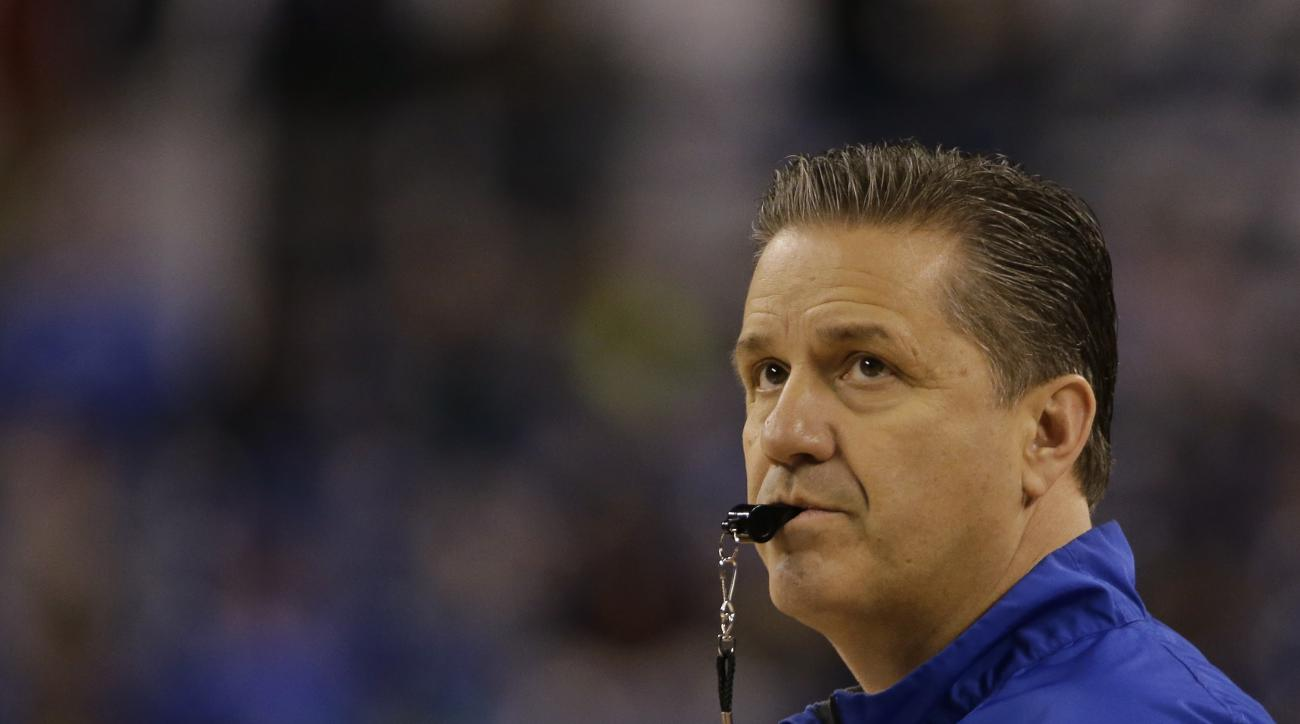 Kentucky head coach John Calipari uses a whistle during a practice session for the NCAA Final Four tournament college basketball semifinal game Friday, April 3, 2015, in Indianapolis. Kentucky plays Wisconsin on Saturday. (AP Photo/David J. Phillip)