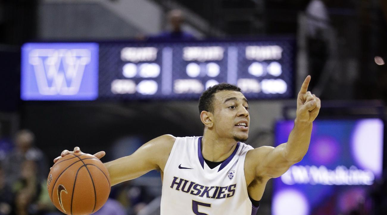 Washington's Nigel Williams-Goss in action against Stanford in an NCAA college basketball game Wednesday, Jan. 28, 2015, in Seattle. (AP Photo/Elaine Thompson)