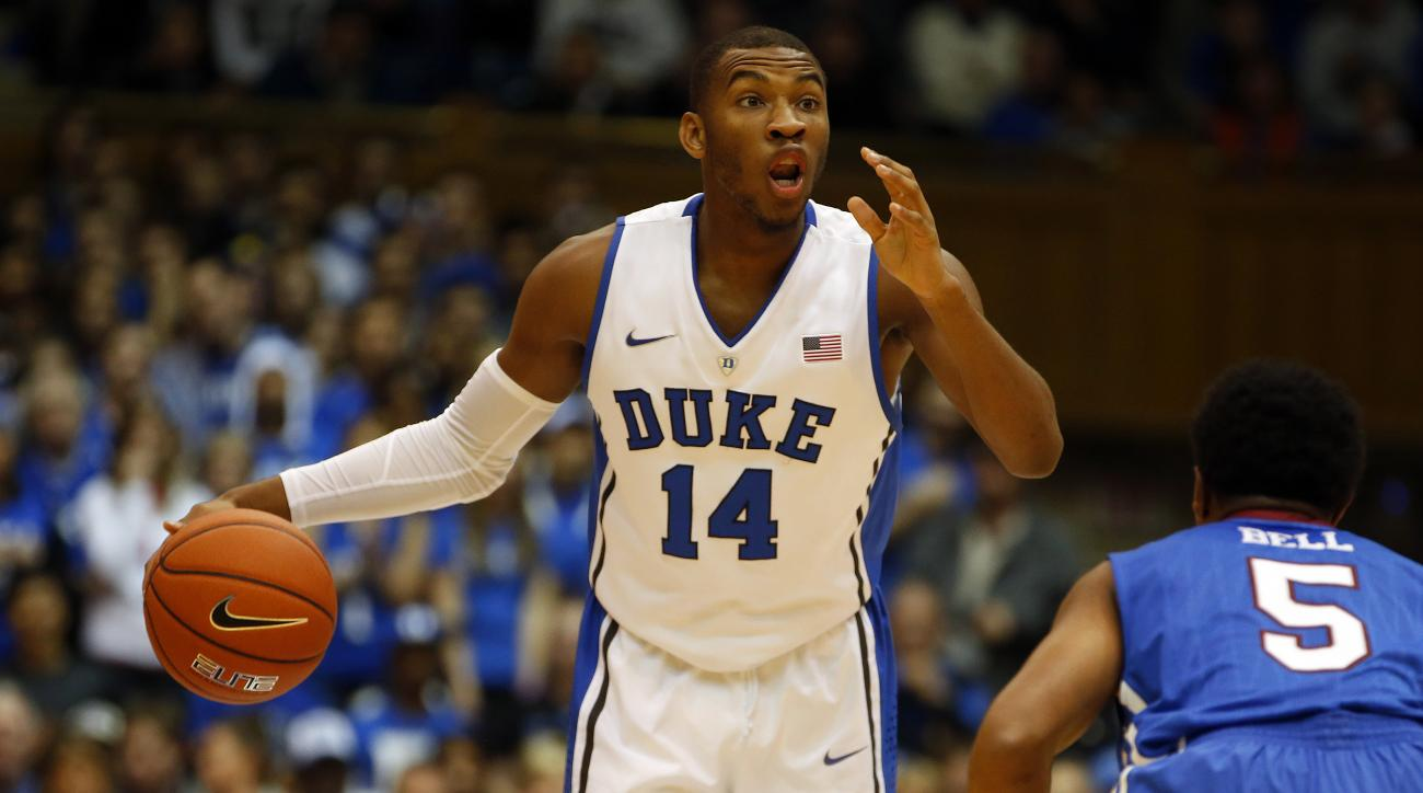 Duke's Rasheed Sulaimon (14) starts a play in front of Presbyterian's Davon Bell (5) during the first half of an NCAA college basketball game in Durham, N.C., Friday, Nov. 14, 2014. (AP Photo/Karl B DeBlaker)