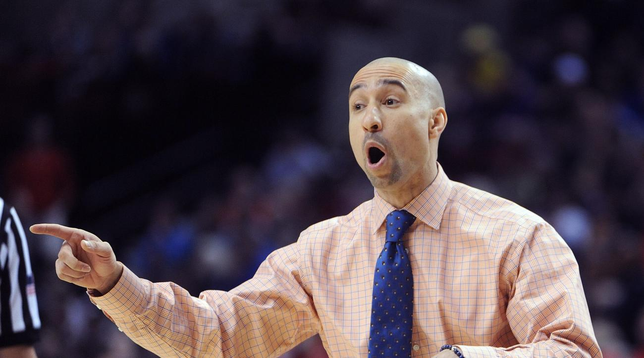 Virginia Commonwealth coach Shaka Smart calls out from the bench during the first half against Ohio State in the second round of the NCAA college basketball tournament in Portland, Ore., Thursday, March 19, 2015. (AP Photo/Greg Wahl-Stephens)