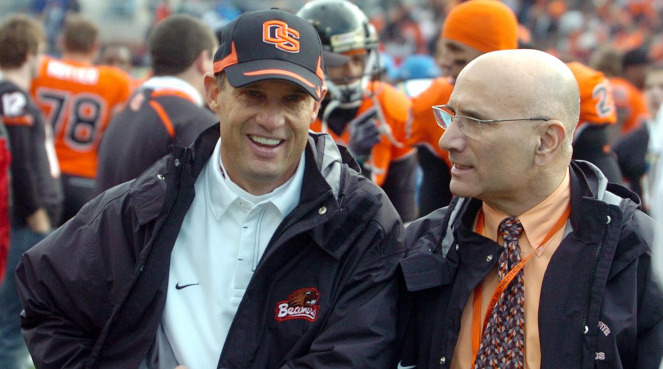Oregon State's head coach Mike Riley, left, with Oregon State Athletic Director, Bob De Carolis, leaves the field at the end of  NCAA college football in Corvallis, Ore., Saturday Oct.  31, 2009. Oregon State beat UCLA 26-19. (AP Photo/Greg Wahl-Stephens)