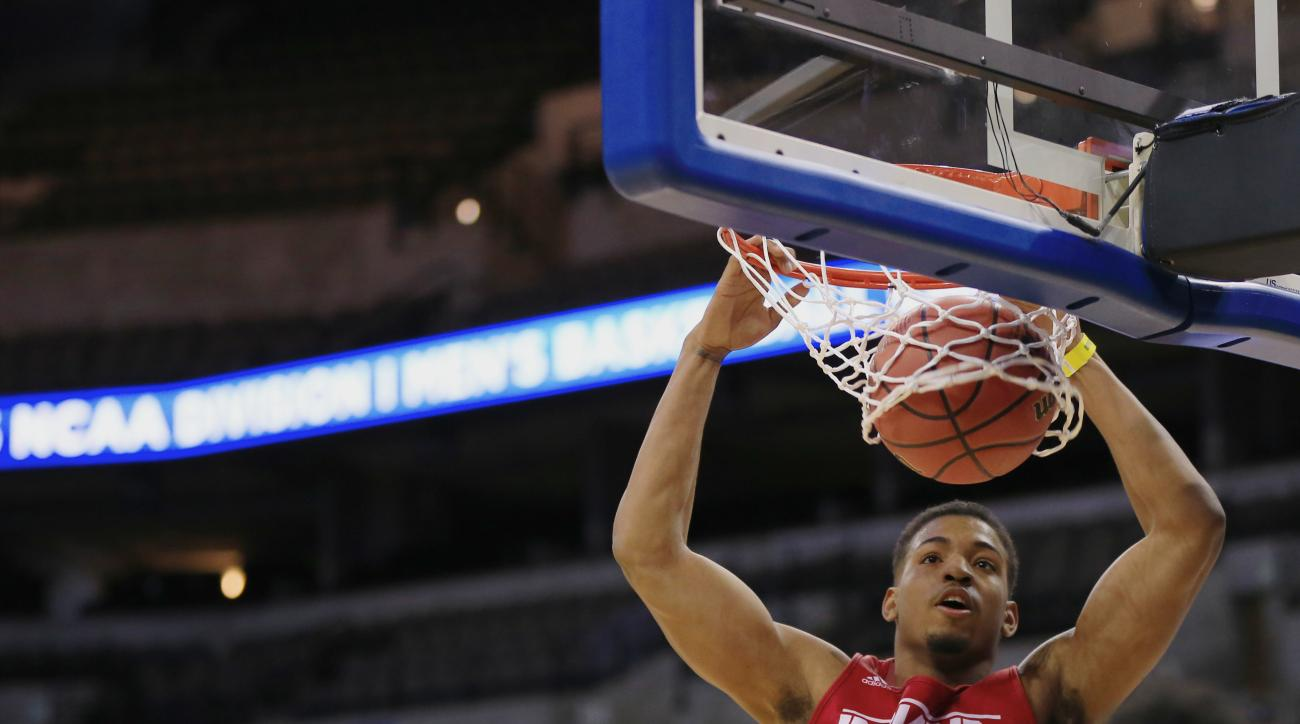Indiana's Devin Davis dunks during practice at the NCAA college basketball tournament in Omaha, Neb., Thursday, March 19, 2015. Indiana plays Wichita State in the second round on Friday. (AP Photo/Nati Harnik)