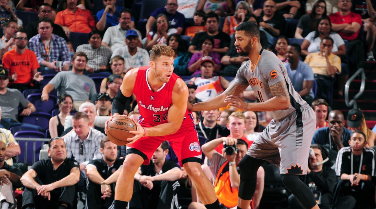 PHOENIX, AZ - APRIL 14: Blake Griffin #32 of the Los Angeles Clippers defends the ball against the Phoenix Suns during the game on April 14, 2015 at U.S. Airways Center in Phoenix, Arizona. (Photo by Barry Gossage/NBAE via Getty Images)