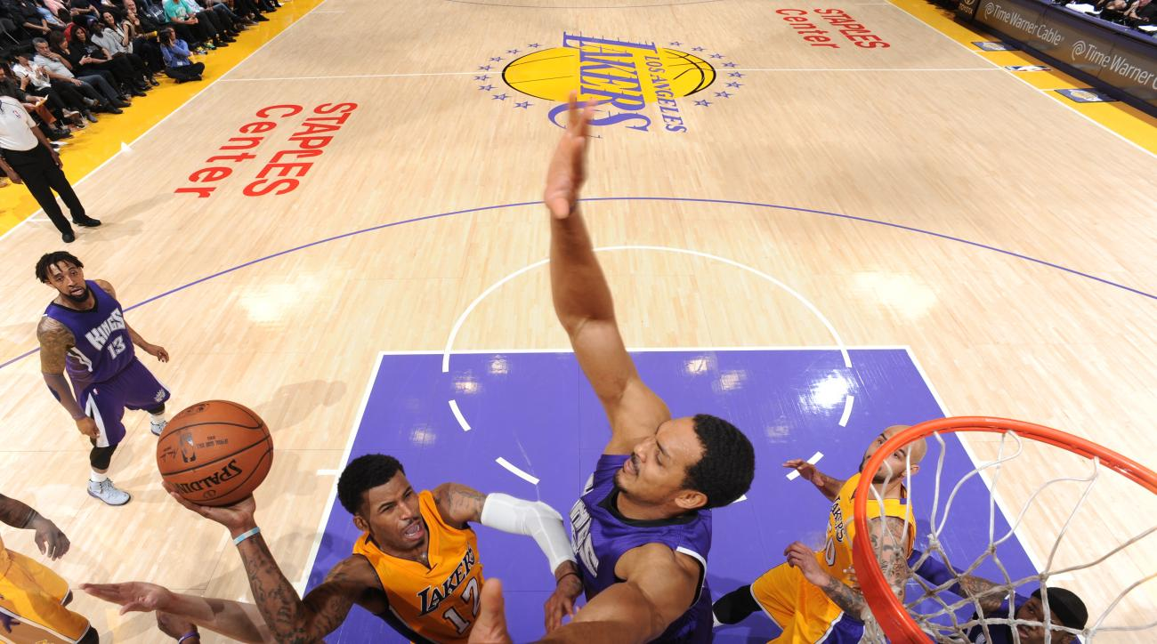 LOS ANGELES, CA - APRIL 15: Vander Blue #12 of the Los Angeles Lakers goes up for a shot against the Sacramento Kings on April 15, 2015 at STAPLES Center in Los Angeles, California. (Photo by Andrew D. Bernstein/NBAE via Getty Images)