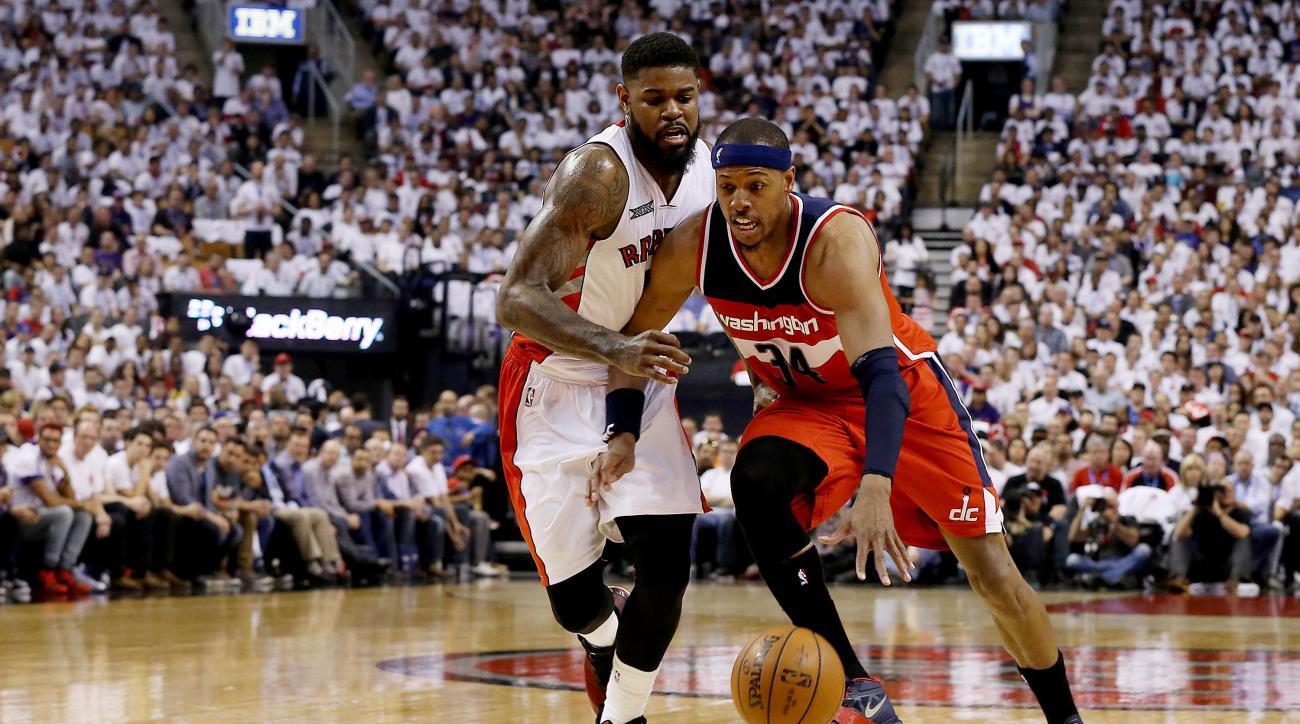 TORONTO,ON - APRIL 18:  Paul Pierce #34 of the Washington Wizards drives to the basket past Amir Johnson #15 of the Toronto Raptors during game one of their NBA Eastern Conference quarterfinal playoffs at the Air Canada Centre on April 18, 2015 in Toronto