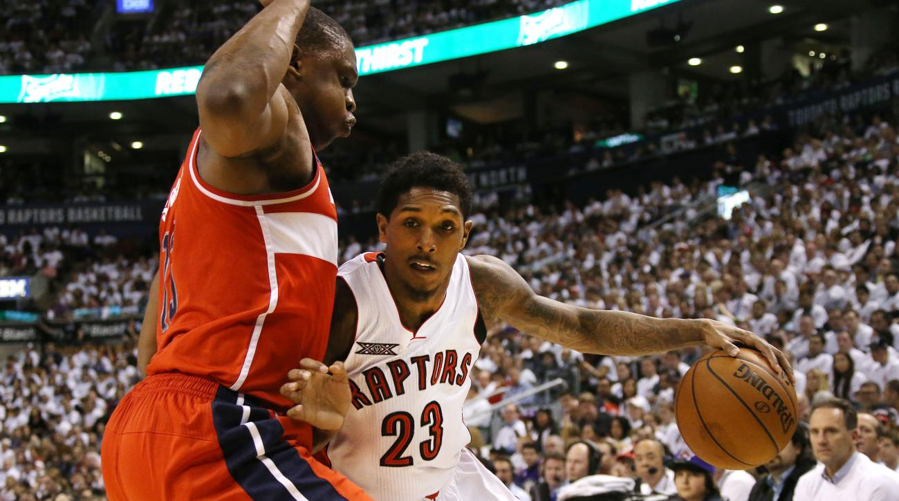 TORONTO,ON - APRIL 18:  Kevin Seraphin #13 of the Washington Wizards defends against Louis Williams #23 of the Toronto Raptors as he drives to the basket during game one of their NBA Eastern Conference quarterfinal playoffs at the Air Canada Centre on Apr
