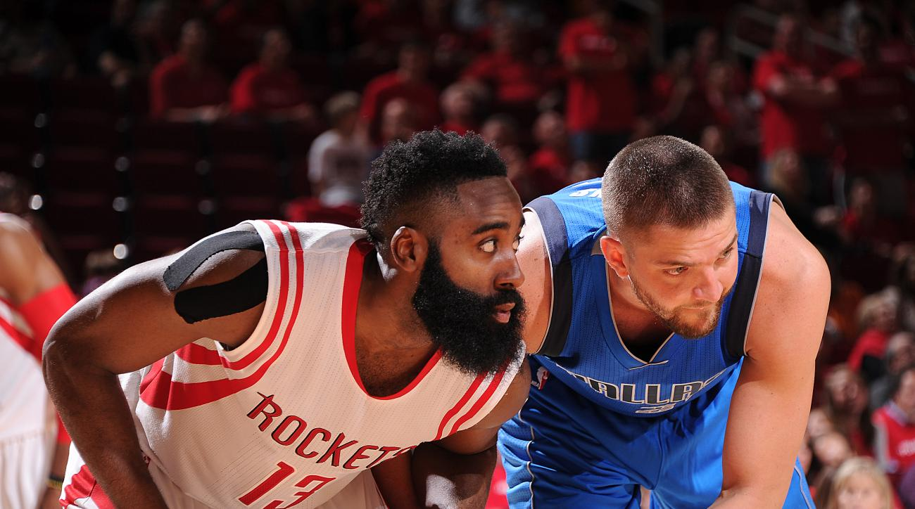 HOUSTON, TX - APRIL 18:  James Harden #13 of the Houston Rockets boxes out against Chandler Parsons #25 of the Dallas Mavericks in Game One of the Western Conference Quarterfinals during the NBA Playoffs on April 18, 2015 at the Toyota Center in Houston,