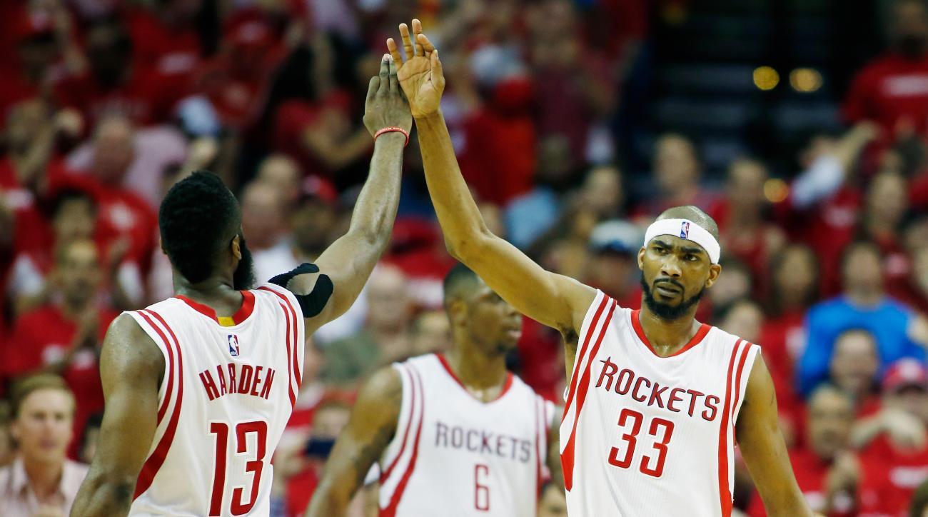 HOUSTON, TX - APRIL 18:  James Harden #13 and Corey Brewer #33 of the Houston Rockets celebrate after a play against the Dallas Mavericks during Game One in the Western Conference Quarterfinals of the 2015 NBA Playoffs on April 18, 2015 at the Toyota Cent