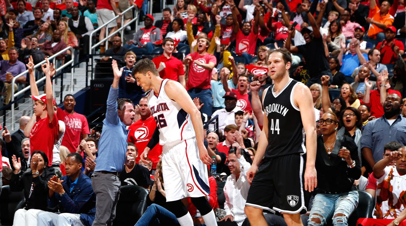 ATLANTA, GA - APRIL 19:  Kyle Korver #26 of the Atlanta Hawks reacts after hitting a three-point basket against Bojan Bogdanovic #44 of the Brooklyn Nets during Game One of the Eastern Conference Quarterfinals of the NBA Playoffs at Philips Arena on April