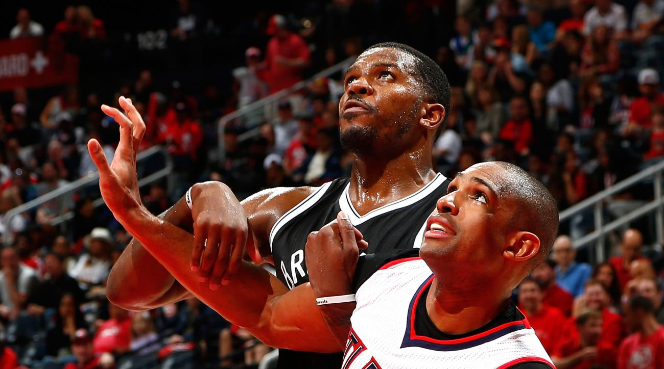 ATLANTA, GA - APRIL 19:  Al Horford #15 of the Atlanta Hawks and Joe Johnson #7 of the Brooklyn Nets battle during a free throw during Game One of the Eastern Conference Quarterfinals of the NBA Playoffs at Philips Arena on April 19, 2015 in Atlanta, Geor