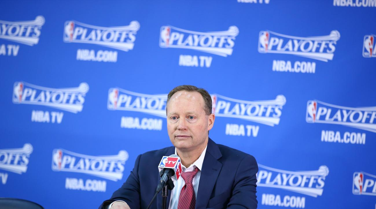 ATLANTA, GA - APRIL 19:  Head coach Mike Budenholzer of the Atlanta Hawks speaks at the post game press conference after Game One of the Eastern Conference Quarterfinals against the Brooklyn Nets during the NBA Playoffs on April 19, 2015 at Philips Arena