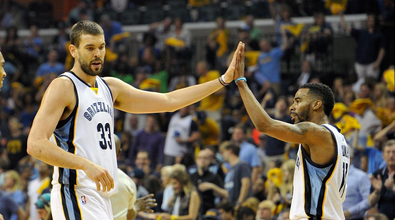 MEMPHIS, TN - APRIL 19:  Marc Gasol #33 of the Memphis Grizzlies high fives teammate Mike Conley #11 in the second quarter of Game One against the Portland Trailblazers in the first round of the 2015 NBA Playoffs at FedExForum on April 19, 2015 in Memphis