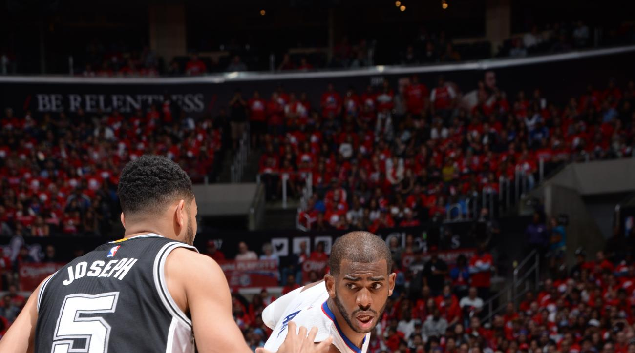 LOS ANGELES, CA - APRIL 19:  Chris Paul #3 of the Los Angeles Clippers handles the ball against Cory Joseph #5 of the San Antonio Spurs in Game One of the Western Conference Quarterfinals during the 2015 NBA Playoffs on April 19, 2015 at Staples Center in