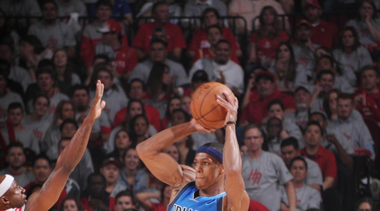 HOUSTON, TX - APRIL 21: Rajon Rondo #9 of the Dallas Mavericks shoots against the Houston Rockets during Game Two of the Western Conference Quarterfinals of the 2015 NBA Playoffs on April 21, 2015 at the Toyota Center in Houston, Texas. (Photo by Bill Bap