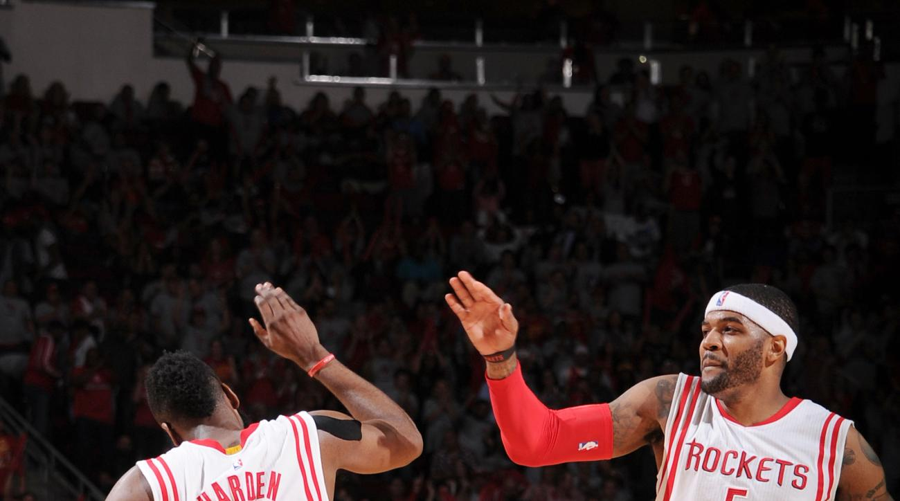 HOUSTON, TX - APRIL 21: James Harden #13 high fives Josh Smith #5 of the Houston Rockets after a play against the Dallas Mavericks during Game Two of the Western Conference Quarterfinals of the 2015 NBA Playoffs on April 21, 2015 at the Toyota Center in H