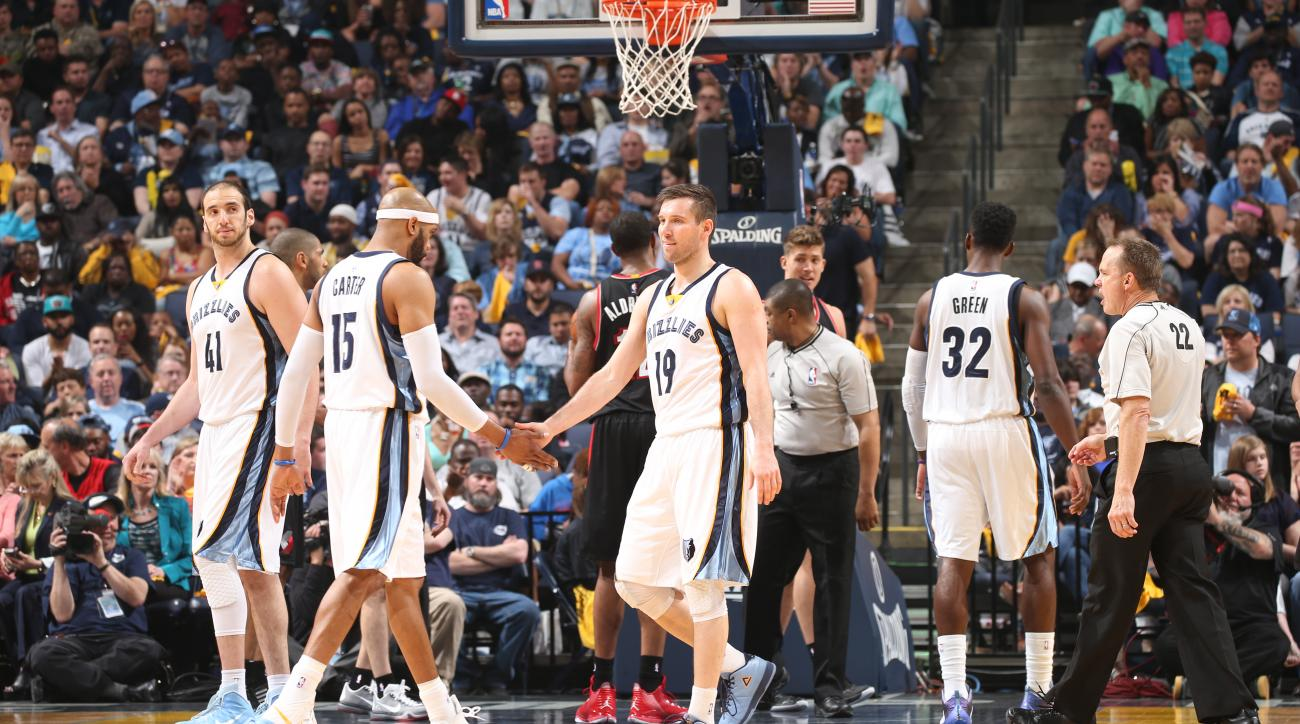 MEMPHIS, TN - APRIL 22:  Vince Carter #15 of the Memphis Grizzlies celebrates with teammate Beno Udrih #19 of the Memphis Grizzlies against the Portland Trail Blazers in Game Two of the Western Conference Quarterfinals during the 2015 NBA Playoffs on Apri