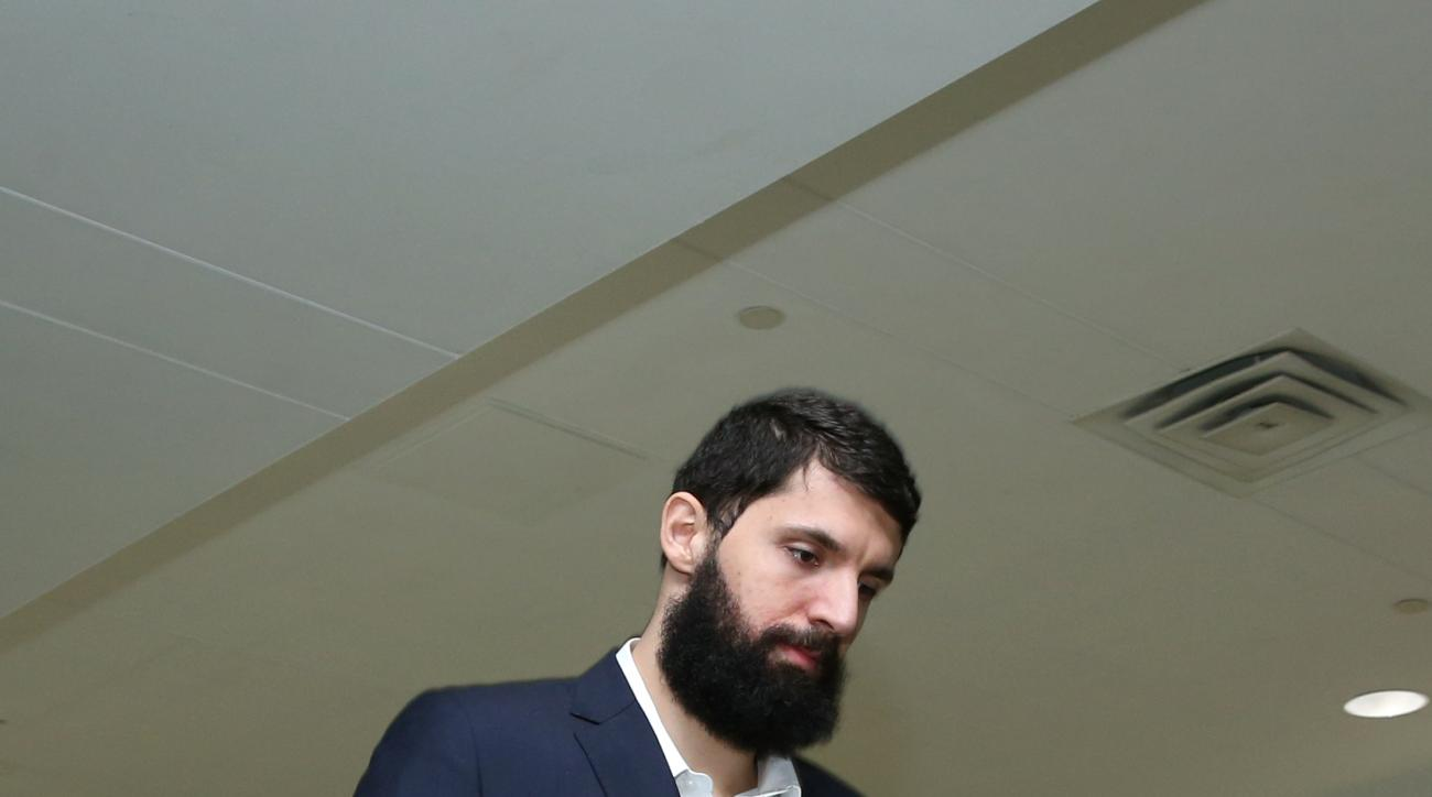 MILWAUKEE, WI - APRIL 23:  Nikola Mirotic #44 of the Chicago Bulls arrives before Game Three of the Eastern Conference Quarterfinals against the Milwaukee Bucks during the 2015 NBA Playoffs on April 23, 2015 at the BMO Harris Bradley Center in Milwaukee,