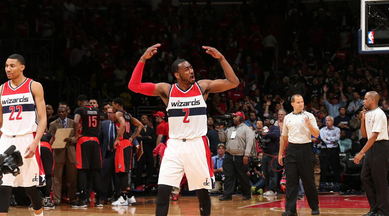 WASHINGTON, DC - APRIL 24:  John Wall #2 of the Washington Wizards celebrates a victory against the Toronto Raptors in Game Three of the Eastern Conference Quarterfinals during the 2015 NBA Playoffs on April 24, 2015 at Verizon Center in Washington, D