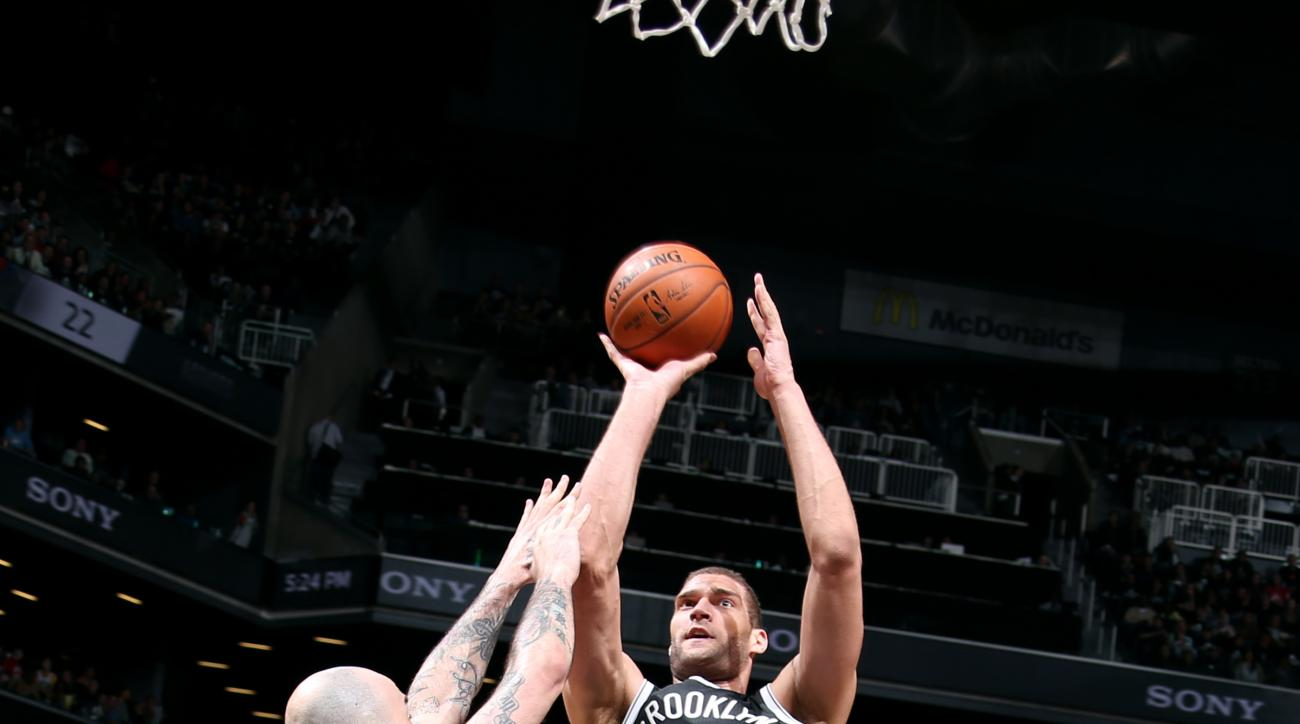 NEW YORK, NY - APRIL 25: Brook Lopez #11 of the Brooklyn Nets shoots against the Atlanta Hawks in Game Three of the Eastern Conference Quarterfinals during the 2015 NBA Playoffs on April 25, 2015 at the Barclays Center in the Brooklyn borough of New York