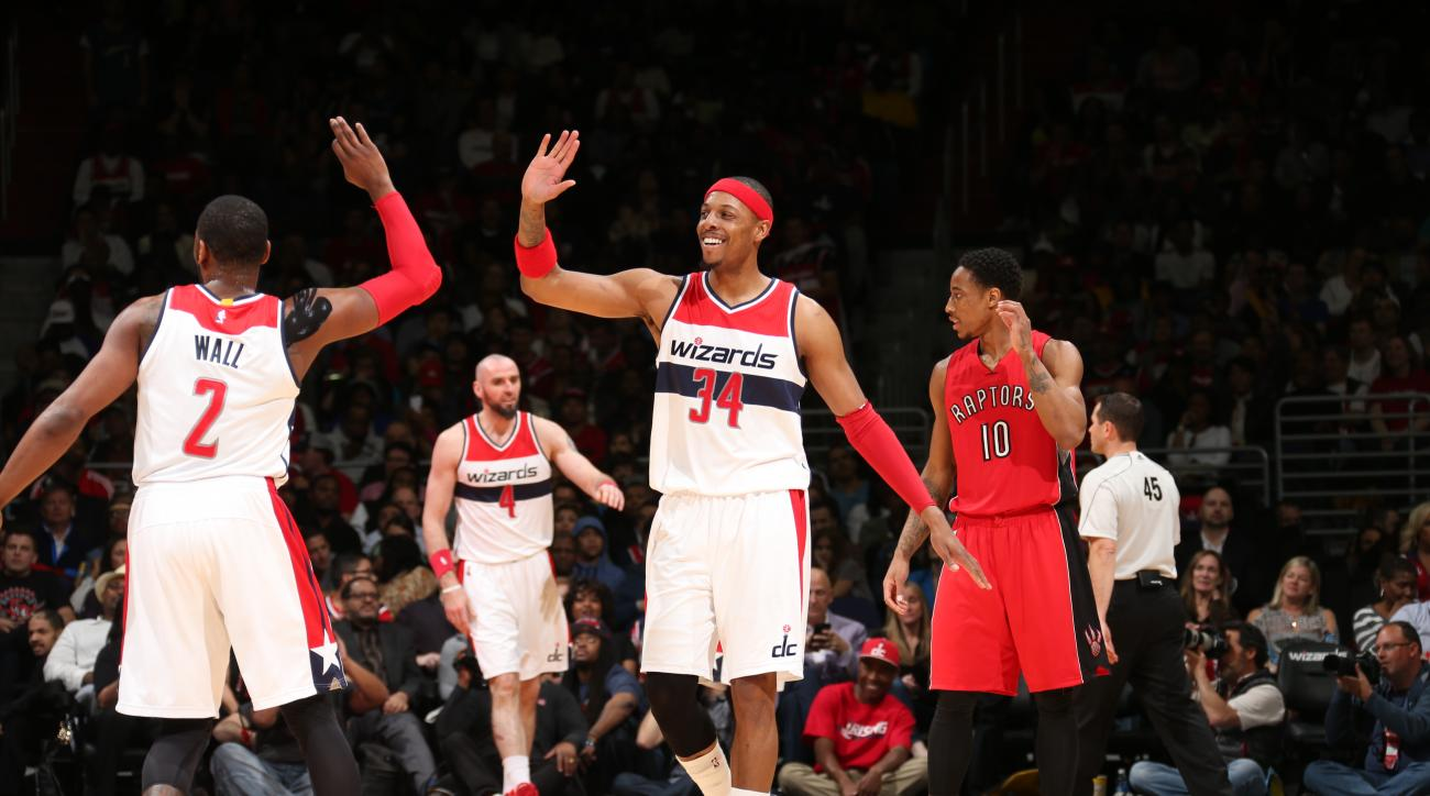 WASHINGTON, DC - APRIL 26:  Paul Pierce #34 of the Washington Wizards celebrates a play with John Wall #2 of the Washington Wizards in Game Four of the Eastern Conference Quarterfinals during the 2015 NBA Playoffs on April 26, 2015 at the Verizon Center i