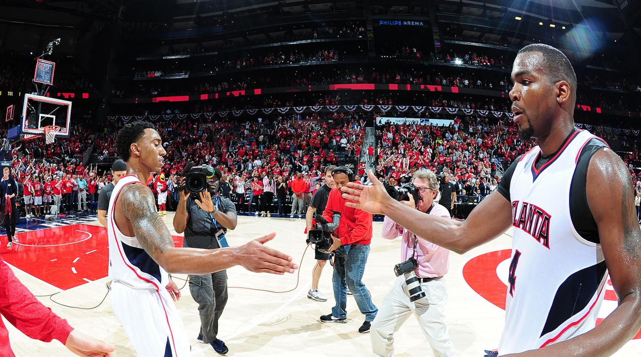 ATLANTA, GA - APRIL 29:  Jeff Teague #0 and Paul Millsap #4 of the Atlanta Hawks celebrate a victory against the Brooklyn Nets in Game Five of the Eastern Conference Quarterfinals during the 2015 NBA Playoffs on April 29, 2015 at Philips Arena in Atlanta,